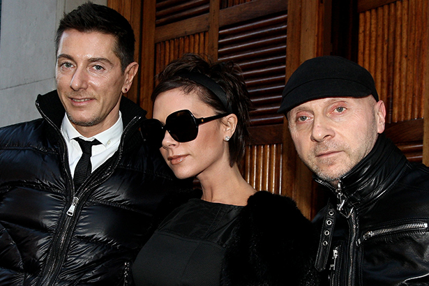 Victoria Beckham with Dolce and Gabbana clad in black puffers, leather coats and oversized sun glasses