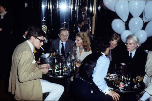"PARIS, FRANCE - 1977 : Yves Saint Laurent, Pierre Berger, and Andy Warhol at a party in ""le Palace"" in 1977 in Paris, France.(Photo by Michel Dufour/WireImage)"