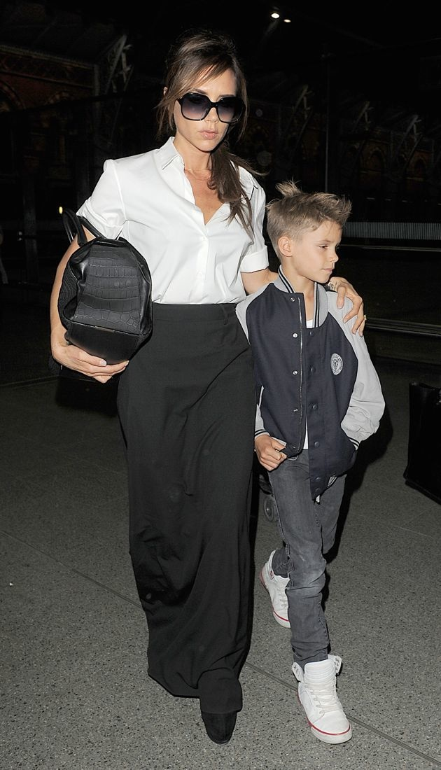 Victoria Beckham and Romeo Beckham arrive at Kings Cross St Station London